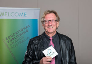 Peter Stannard with his trophy at the educational publishing awards.